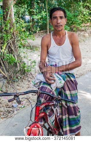 Bagerhat, Bangladesh - November 16, 2016: Local Man With A Bicycle In Bagerhat, Bangladesh