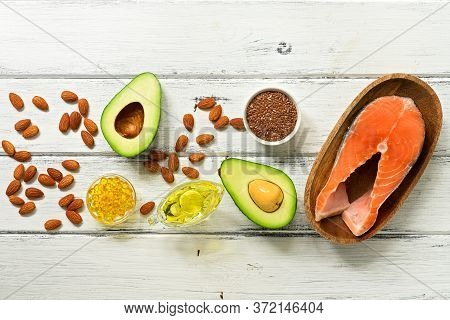 Food High In Omega-3 Fatty Acids On A White Wooden Background, Border. Healthy Eating Concept. Salmo