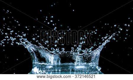 Water splash isolated on black background, freeze motion