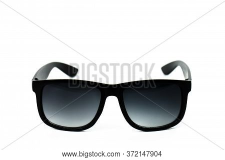 Designer Male And Female Sunglasses In Black Plastic Frame With Black Translucent Lenses Isolated On