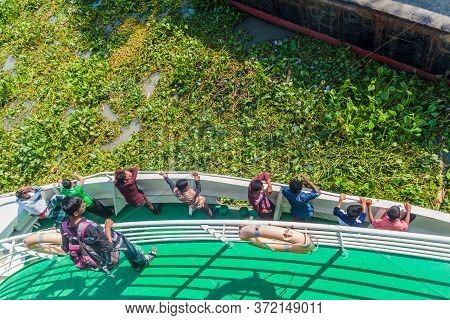 Katcha River, Bangladesh - November 19, 2016: Passengers Of Mv Modhumoti Ship Watch A Pier, Banglade