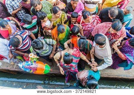 Hularhat, Bangladesh - November 19, 2016: Passengers Boarding A River Ship At Hularhat Launch Ghat P