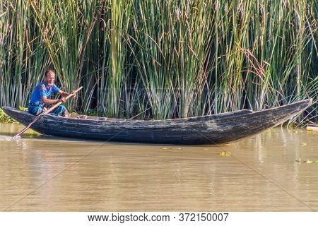 Sandha River, Bangladesh - November 19, 2016: Man On A Small Boat On Sandha River, Bangladesh