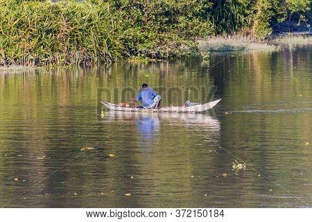 Sandha River, Bangladesh - November 19, 2016: Fisherman On A Small Boat On Sandha River, Bangladesh