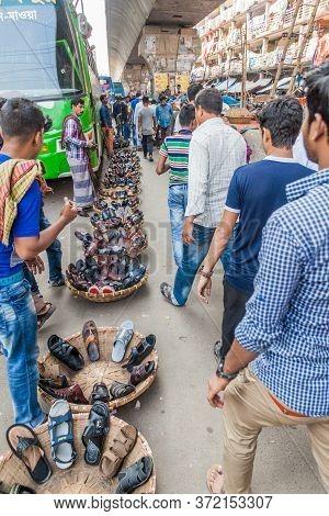 Dhaka, Bangladesh - November 21, 2016: Shoe Seller With His Merchandise On A Street In Dhaka, Bangla