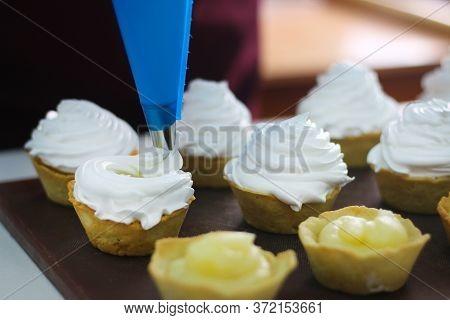 Mini Tartlet With Lemon And Meringue. Tartlet With Italian Meringue And Lemon Cream Selective Focus