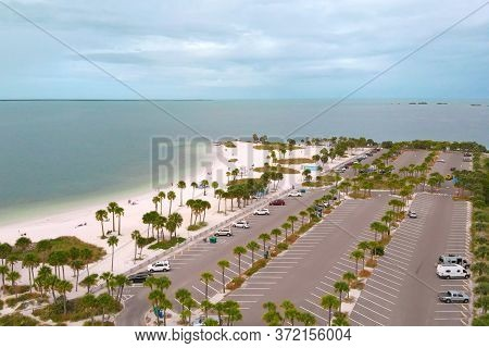 Drone Flies Around Howard Park Beach On The Background Of The Gulf Of Mexico, Aerial View. Car Parki
