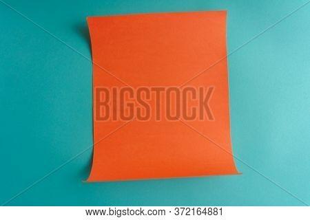 empty orange post on blue wall.