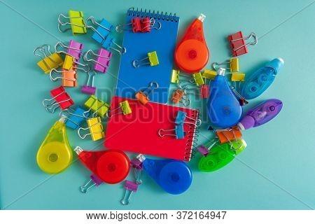 office supplies on blue bakcground.
