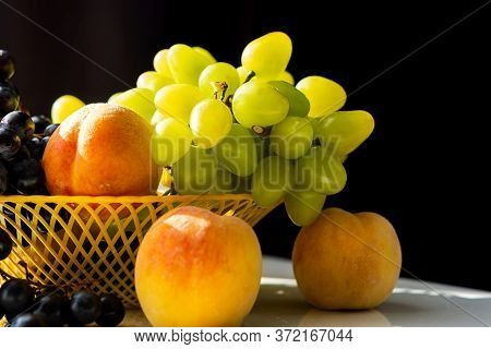 Peaches And Grapes Close-up. Macro Photography Of Fruit In Natural Light. Ripe Juicy Peaches. Sweet
