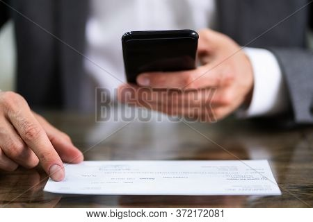 Scanning Remote Deposit Check Document Using Phone. Taking Photo