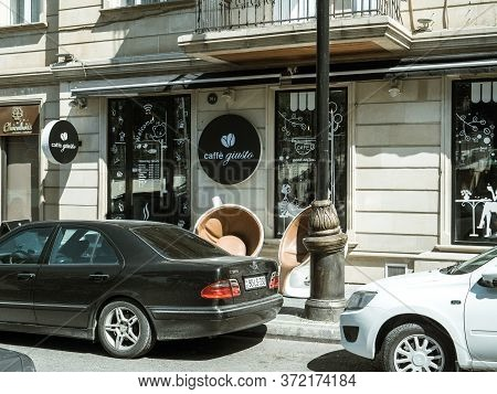 Baku, Azerbaijan - May 2, 2019: Cafe Giusto In Central Baku On 5 Niyazi Street With Black Mercedes-b