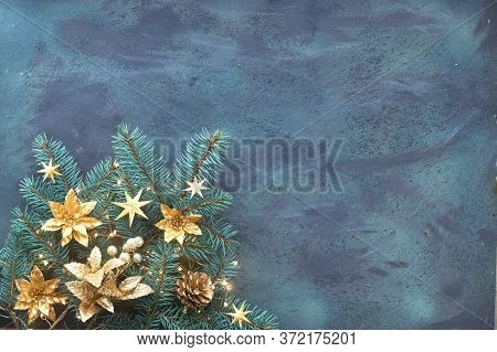 Christmas Or New Year Panoramic Flat Lay Background, With Copy Space. Fir Twigs Decorated With Golde