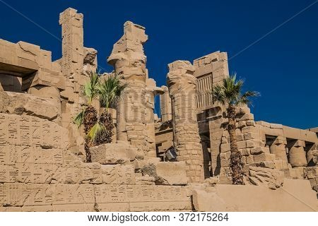 Mighty stone pillars of Luxor Temple in Luxor, ancient Thebes, Egypt. Luxor Temple is a large Ancient Egyptian temple complex located on the east bank of the Nile River