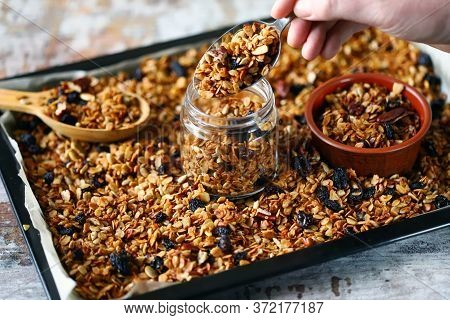 Selective Focus. Fresh Homemade Granola. Healthy Breakfast Or Snack. Cooking Granola. Cooking Breakf