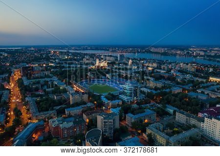 Voronezh City Center In Evening With Stadium, Roads And Many Buildings, Aerial View.
