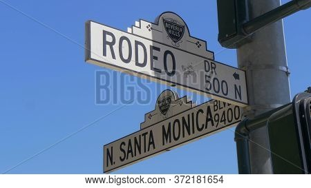 Street Sign Santa Monica Blvd And Rodeo Drive In Beverly Hills - Los Angeles, Usa - March 18, 2019