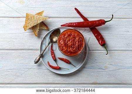 Hot Chili Pepper Tomato Sauce Pasta With Garlic In A Bowl Close-up. Adjika, Harissa Sauce - Hot Chil