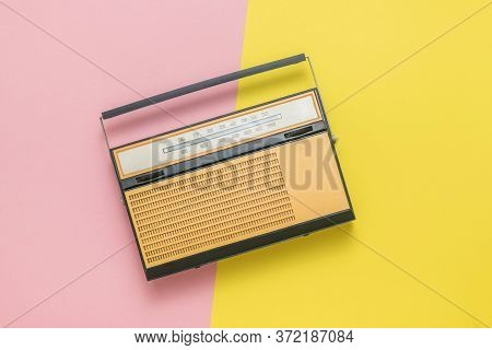 Retro Radio On A Yellow And Red Background. Radio Broadcast Live. Vintage Technique.