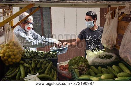 Delhi - India\n19th June 2020\nan Indian Customer And Vegetable Seller Maintaining Social Distancing