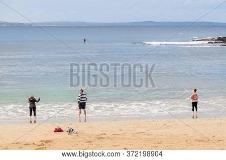 Bendalong, Australia 2020-06-07 People Fishing In The Ocean On A Sandy Boat Harbour Beach, Bendalong