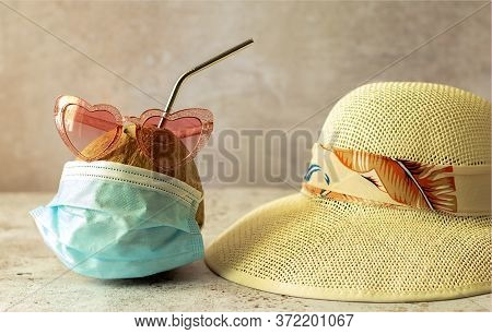 Coconut In Sunglasses And Medical Masks And Straw Beach Hat. Sea Vacation During Coronavirus Pandemi