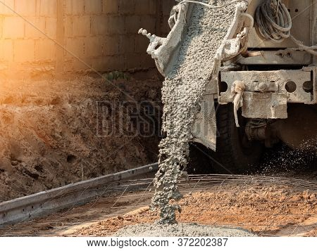 Pouring Ready-mixed Concrete After Placing Steel Reinforcement To Make The Road By Mixing In Constru