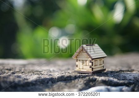 Small House In The Forest, Wooden Model House On Nature