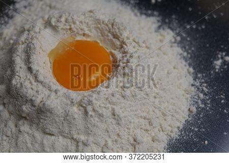 Egg Yolk On Flour, Cooking Egg And Flour For Bakery