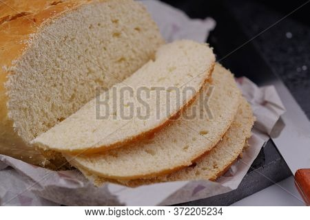 Sliced White Bread On A Plate And Paper
