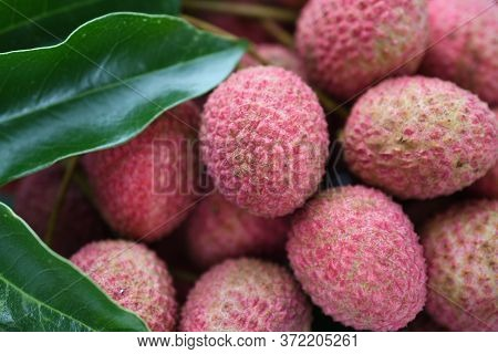 Lychee Sweet Fruit On A Wooden Table