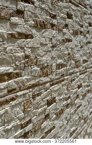 The Texture Of The Uneven Outer Wall Of The Building. A Close-up Of The Exterior Of A Building In A