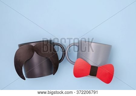 Funny Mustache And Bow Tie On The Cups. Mug With A Mustache And A Red Butterfly On A Blue Background
