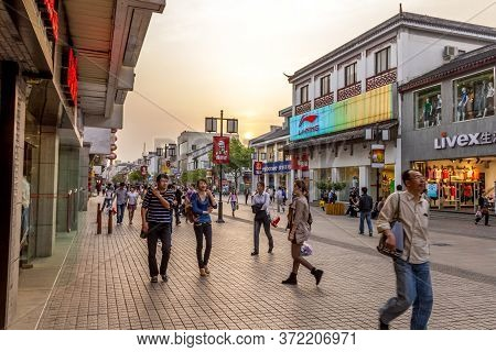Suzhou, China - 26 April, 2011: People walking in the Guanqian street. The place most bustling comme
