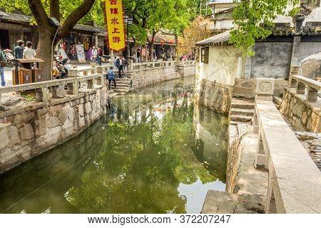 Suzhou, China - 4 April, 2011: People Walking In Suzhou Market Street. Suzhou Is Often Dubbed The