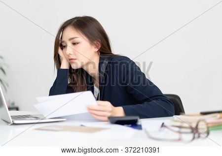 Overhelmed Tired Young Asian Woman Sitting At Her Desk Worker Wasting Time At Workplace Distracted F
