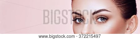 Beautiful Young Woman With Clean Fresh Skin. Perfect Makeup. Eyelashes. Eyelash Extensions. Cosmetol