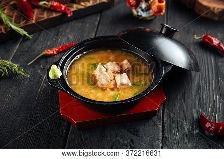 Appetizing Ishikari Miso Soup With Salmon In A Black Bowl, Horizontal