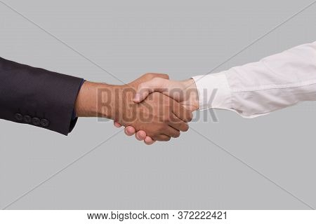 Hand Shake White And Black Businessmen. International Friendship Hand Shake. Black Lives Matter