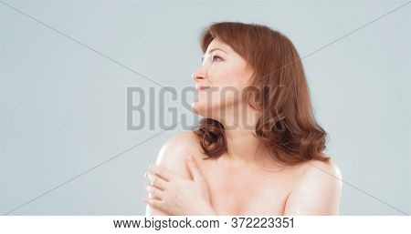 Side View Of Pretty Nude Woman Looking At Left Side On Textspace. Mature Caucasian Woman Cut Out On