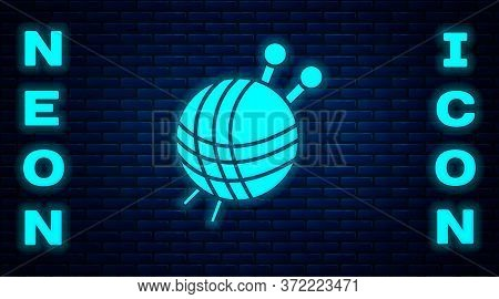 Glowing Neon Yarn Ball With Knitting Needles Icon Isolated On Brick Wall Background. Label For Hand