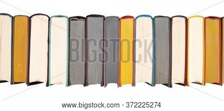 Stack Of Hardcover Books On Bookshelf. Close-up View Of Multicolored Vintage Hardback Books Isolated