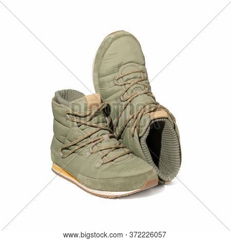 Trekking Or Hiking Puffy Boots. Light Green Shoes With Lacing For Cool Season. Cut Out On White Back
