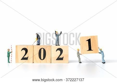 Miniature Worker Team Create Wooden Block Number 2021 , Happy New Year Concept
