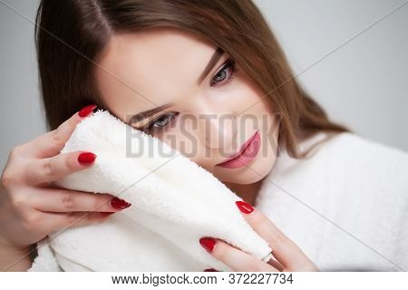 Cleansing Facial Skin, Young Woman Holding White Towel Near Facial Skin After Washing Face