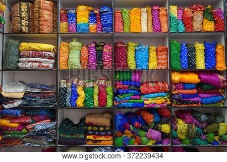 Traditional Rajasthan Dress Materials For Sale In A Cloth Merchant Shop In India. Colorful Jodhpur F