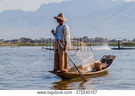 Inle, Myanmar - November 28, 2016: Local Fisherman At Inle Lake Catching Fish In A Traditional Way W