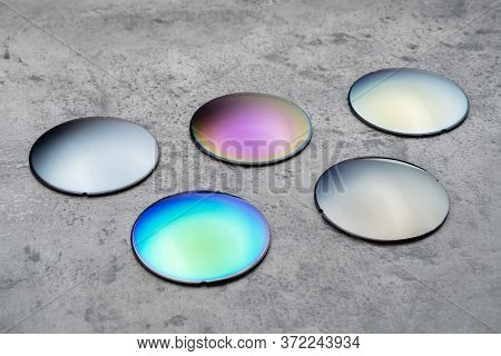 Close Up Of Optical Lenses For Sunglasses With Different Color. Production And Adjust Of New Eyeglas