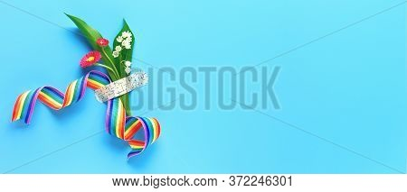 Thank You Doctors And Nurses Rainbow Ribbon And Bouquet Of Red Primrose And Lily Of The Valley Flowe