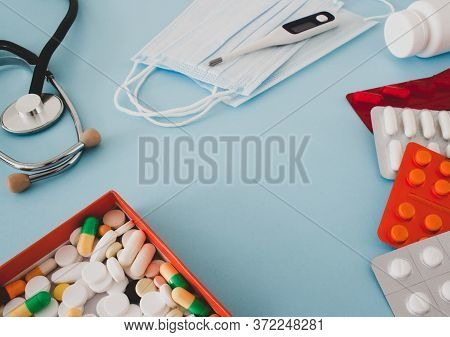 Colorful Tablets And Capsules In A Box, Thermometer, Statoscope, Medical Mask, Container, Vitamins,